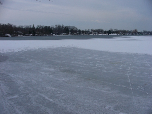 My 69x61 ft rink three quarters done. Notice water/ice edge that footprints led to.